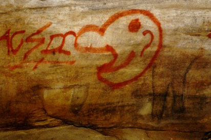 Aboriginal art destroyed by graffiti.