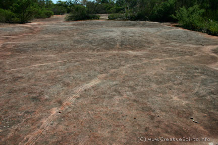 Skid marks on an Aboriginal rock engravings site.