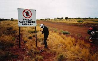 'No grog' sign on a remote outback road.