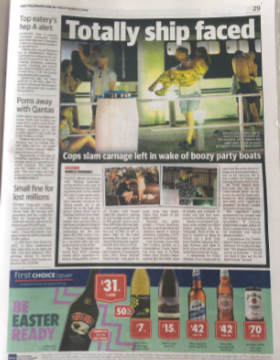 An article about Australian youth's alcohol consumption is seen besides an advert for alcohol.