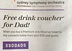 "Detail of an advertising campaign saying ""Free drink voucher for dad!"""