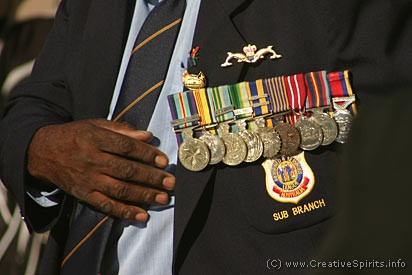 Coloured Digger on Anzac Day displaying his medals.