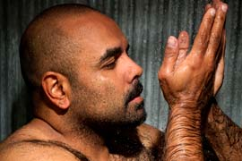 A portrait of an Aboriginal man in his shower.