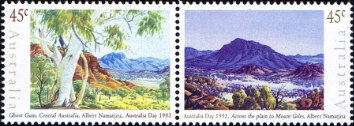 One stamp shows a white-barked ghost gum, another a solitary mountain.