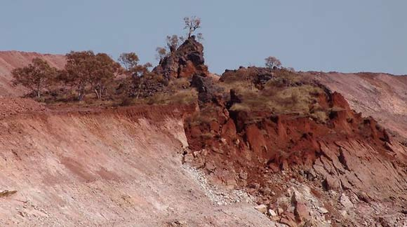 An Aboriginal sacred site surrounded by a mining site where one half has dropped down a few metres.