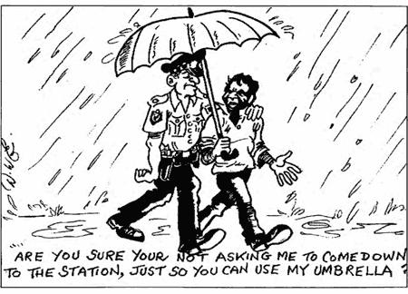 A police officer escorts an Aboriginal man in the rain.