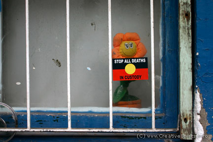 Sticker on residential window saying 'Stop all deaths in custody'