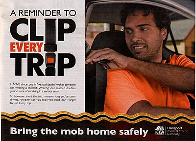 Advertisement reading 'A reminder to clip every trip - Bring the mob home savely', showing an Aboriginal driver reaching for the buckle.