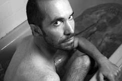 Portrait of Raymond in his bathtub.