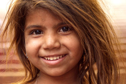 An Indigenous child smiling.