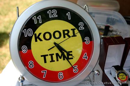 Koori Time clock in Aboriginal colours.