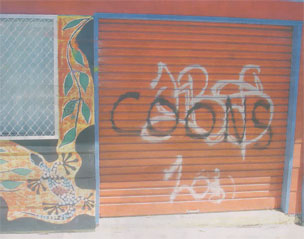 A 'Coon' graffiti has been sprayed on an Aboriginal youth organisation's gate.