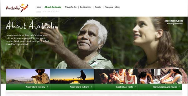 Screenshot of australia.com showing an Aboriginal tour guide with a white visitor.