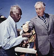 Prime Minister Gough Whitlam pours soil into the hand of Aboriginal elder Vincent Lingiari.