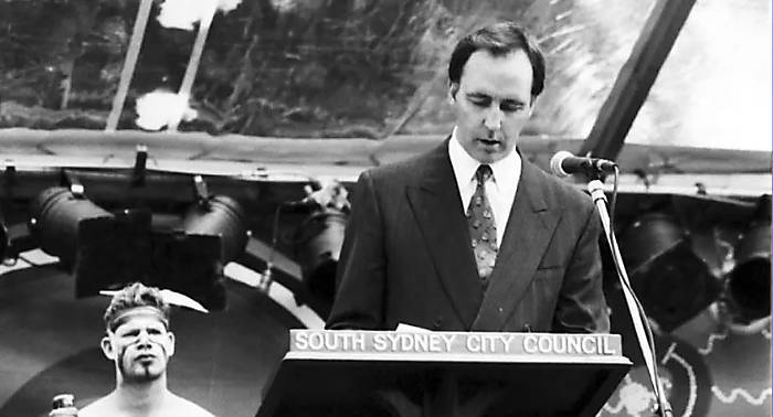Paul Keating is standing at a lectern delivering his speech