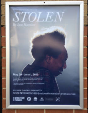 A poster of a Stolen Generations play shows the head of an Aboriginal woman.