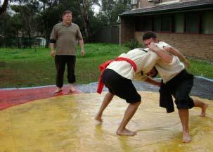 Two men fighting Coreeda - Traditional Aboriginal wrestling