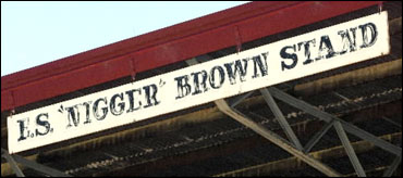Sign reading 'ES Nigger Brown Stand'.