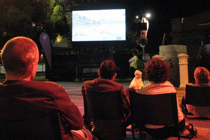 Video screening of First Australians on Taylor Square, Sydney.