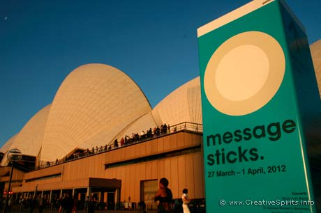 Message Sticks Indigenous Film Festival - Opera House and a sign of the festival bathed in late afternoon sun.