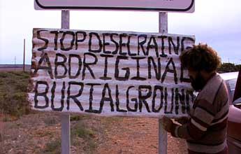 Quenten Agius puts up a protest sign.